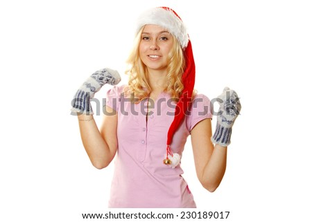 Close-up of beautiful young girls in warm mittens and a red Santa Claus hat. Isolated on a white background - stock photo