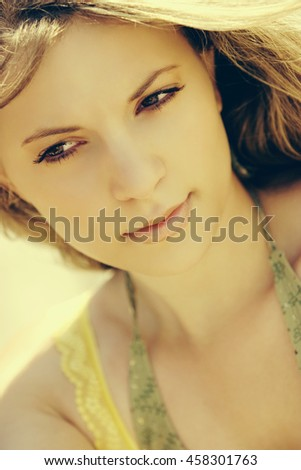 Close up of beautiful young woman - stock photo
