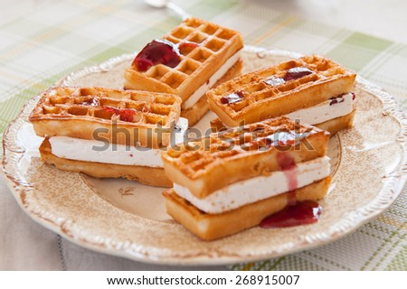 close up of belgian waffles on a plate  - stock photo