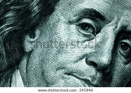 close up of Benjamin Franklin on a one hundred dollar bill - stock photo