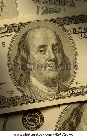 Close-up of Benjamin Franklin on the $100 bill, dramatically lit. - stock photo