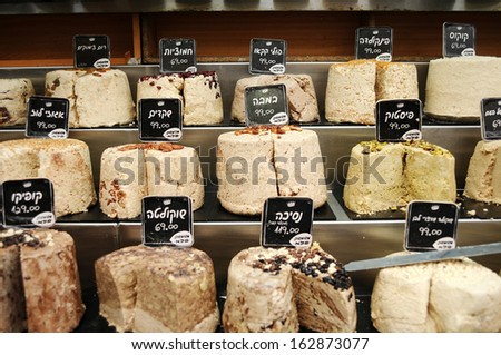 Close up of big pieces of halva on market stand - stock photo