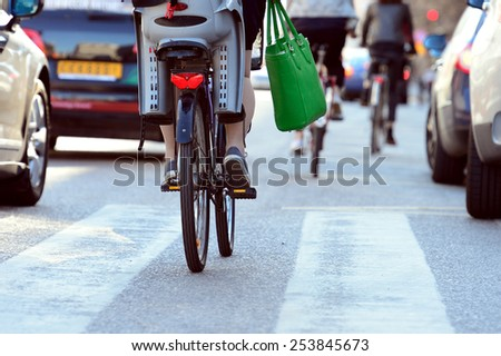 Close up of bike and bicyclist in traffic - stock photo