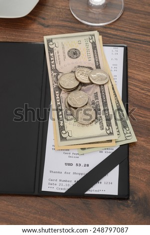 Close-up Of Bill With American Dollars On Wooden Table - stock photo