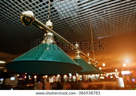 Close up of billiard lamps over pool - stock photo