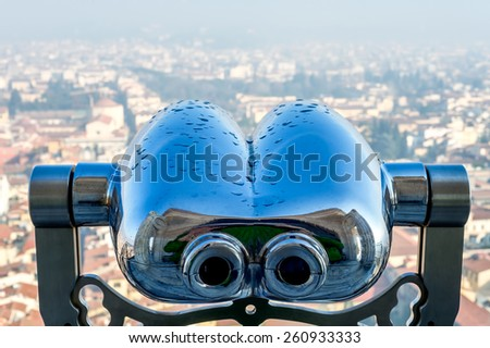 Close-up of binocular with view from Florence Duomo on background.  Florence, Tuscany, Italy. - stock photo