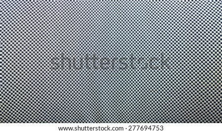 Close-up of black and white checker fabric texture. - stock photo