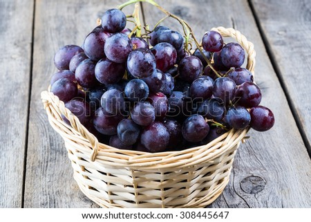 Close up of black grapes in a basket. - stock photo