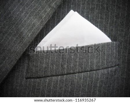 Close-up of black men's suit chest pocket. Vertical version please check  Image ID: 142145656. - stock photo