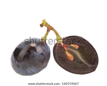 Close up of black ripe grapes. Isolated on a white background. - stock photo