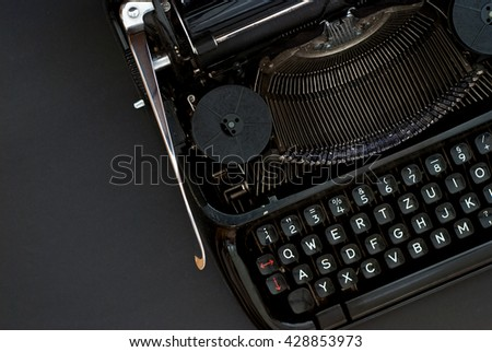 close up of black typewriter - studio shot from above - natural light - vintage object - stock photo