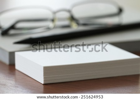 close up of Blank business cards with pencil and glasses on office wooden table - stock photo