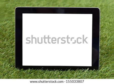 Close-up Of Blank Digital Tablet On Green Grass - stock photo
