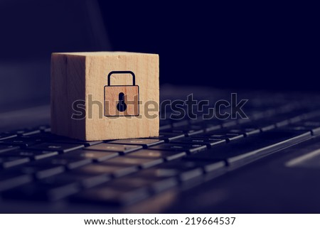 Close Up of Block with Lock Graphic on Black Computer Keyboard in Security Themed Image. - stock photo