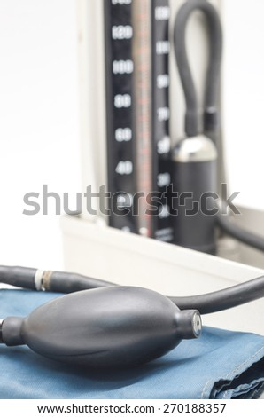 Close up of blood pressure meter for medical equipment isolated on white background - stock photo