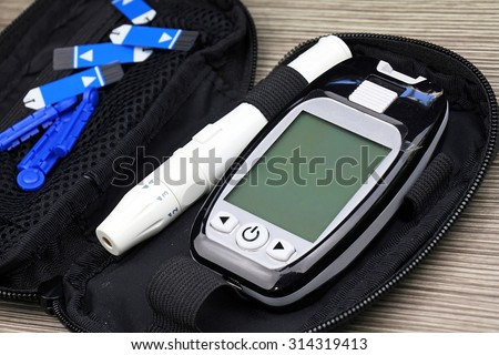 Close up of Blood sugar measurement, Diabetic kit, Syringe pen with insulin and glucometer, Blood glucose test, Blood glucose meter kit. - stock photo