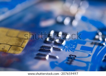 Close up of blue credit card with chip - shallow depth of field - stock photo