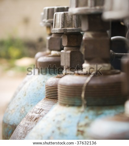 Close-up of blue gas cylinders - stock photo