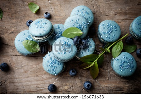 Close up of blueberry macaroons with white filling - stock photo