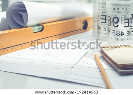 Close-up of blueprint and tools - stock photo
