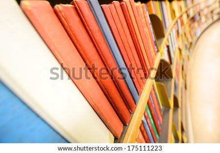 Close up of books in book shelf - stock photo