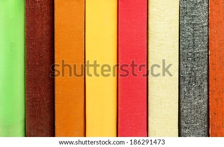 Close-up of books without titles books in bookshelf - stock photo