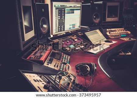 Close-up of boutique recording studio control desk. - stock photo