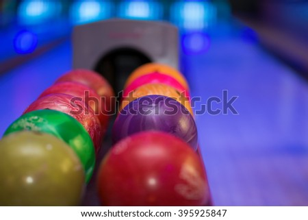 Close up of bowling balls with bowling lane in the background. - stock photo