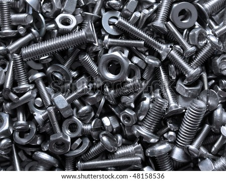 close up of bright and shiny nuts, bolts and washers - - stock photo