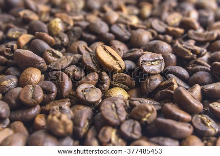 Close up of brown coffee beans. Selective focus. - stock photo
