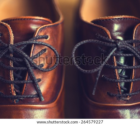 Close up of brown leather men's shoes - stock photo