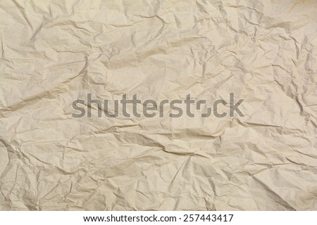 Close up of brown wrinkled paper texture background - stock photo
