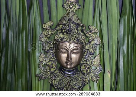 Close up of Buddha face - stock photo