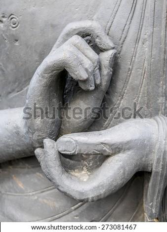close up of buddha statue, hands making meditation gesture - stock photo