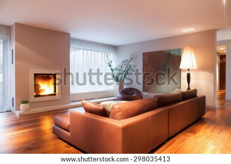 Close-up of burning fireplace in living room - stock photo
