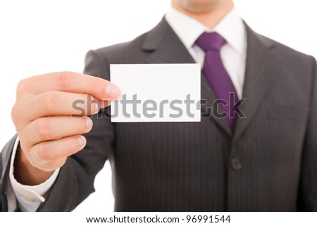 Close-up of business card in business man hand - stock photo