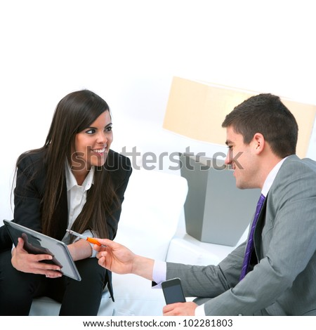 Close up of Business couple at meeting using digital tablet. - stock photo
