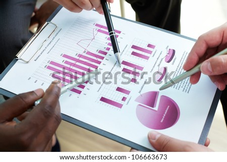 Close-up of business document being discussed at meeting - stock photo
