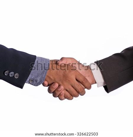 Close- up of business handshake - stock photo