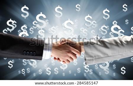 Close up of business handshake on digital background - stock photo