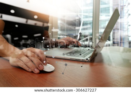 close up of business man hand working on laptop computer on wooden desk with social media diagram                                                                 - stock photo