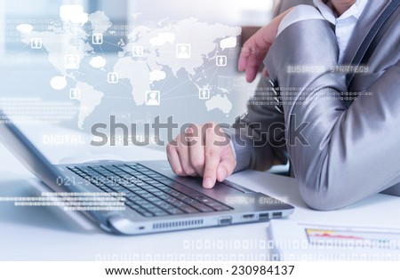 Close up of business man typing on laptop computer with technology layer effect - stock photo