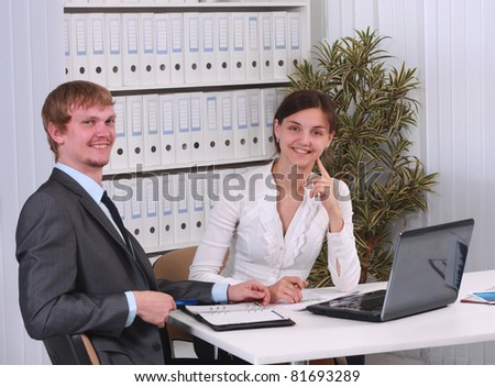 Close-up of business partners hands during discussion in working environment - stock photo