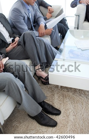 Close-up of business people in a waiting room before a job interview - stock photo