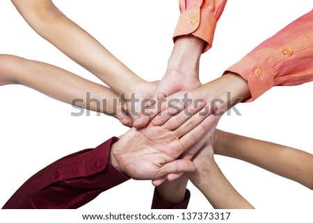 Close-up of business people joining their hands on white background - stock photo