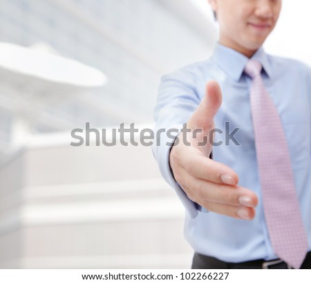 Close up of business people shaking hands over a deal at office - Indoors, model is a asian man - stock photo