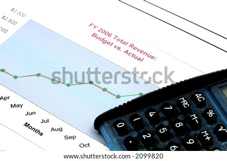 Close up of Business Report with Calculator - stock photo