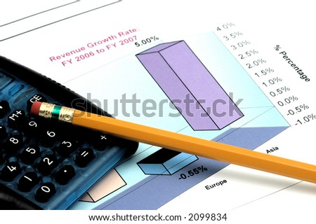 Close up of Business Report with Pencil and Calculator - stock photo