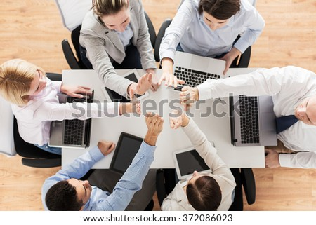 close up of business team showing high five - stock photo