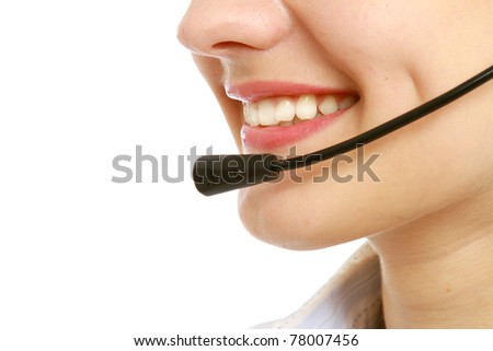 Close-up of business woman's lips with microphone - stock photo